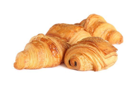 Group of french pastry - croissants and petit pain au chocolat isolated on white background