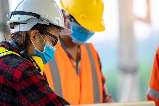 Construction workers wear protective face masks to prevent the spread of Covid 19 by wearing a face mask,Corona virus disease.