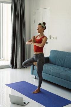Woman doing yoga online