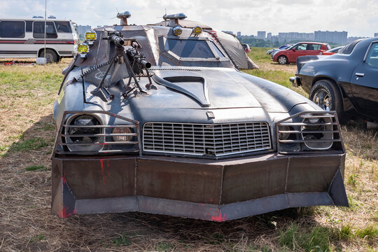 Moscow, Russia - May 25, 2019: Chevrolet Camaro tuned and remade for survival with a zombie apocalypse. Armored with a mounted machine gun. Parked in the field. front side
