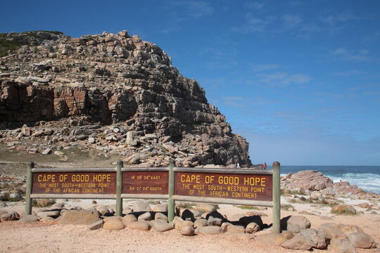 View of Cape Of Good Hope sign with rock under blue sky on the Atlantic coast of the Cape Peninsula in South Africa.