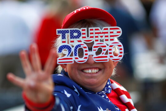 A supporter gestures before a campaign rally from Donald Trump Jr for U.S. President Trump ahead of the Election Day, in Scottsdale