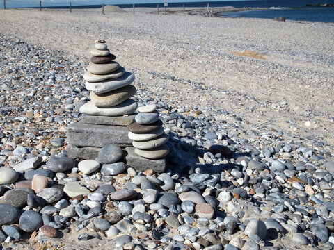 two cairns (stack of stones) at the beach of Düne (Dune) island at the archipelago of Heligoland, Germany