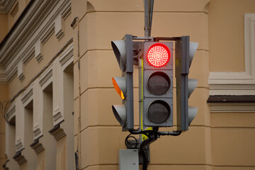traffic light on the street with a burning red signal. Fotomurales