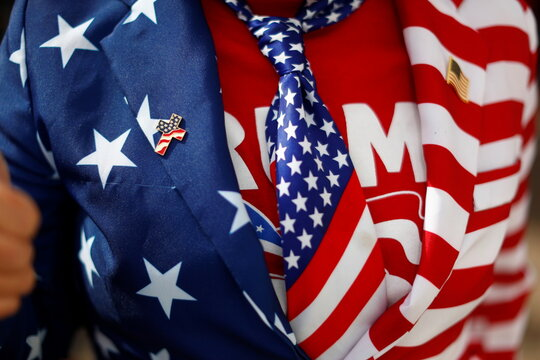 A supporter wearing the colors of the U.S. flag attends a rally from Donald Trump Jr for U.S. President Donald Trump ahead of Election Day in Scottsdale, Arizona
