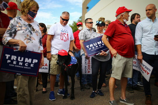 Supporters arrive to take part in a campaign rally from Donald Trump Jr for U.S. President Donald Trump ahead of Election Day in Scottsdale, Arizona