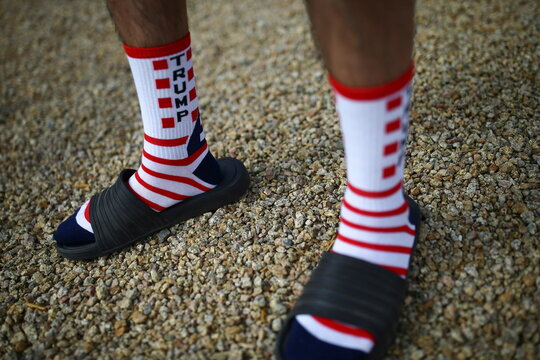 A supporter wearing Trump socks attends a campaign rally from Donald Trump Jr for U.S. President Donald Trump ahead of Election Day in Scottsdale, Arizona