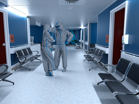 Doctor and nurse wearing Personal protective equipment and talking inside a hospital