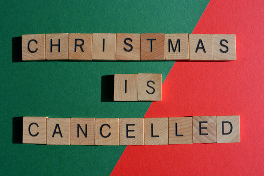 Christmas is Cancelled, words in wooden alphabet letters isolated on red and green