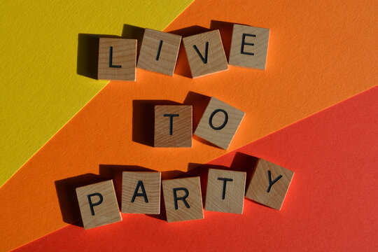 Live to Party,words in wooden alphabet letters isolated on colourful background,