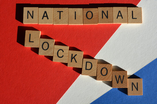 National :ockdown, words in wooden alphabet letters on red, white and blue background