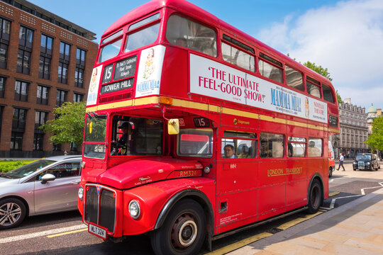 London, Uk - May 23 2018: Old model of classic London Bus with open deck  at St. Paul's Cathedral, the bus still operated through the city of London