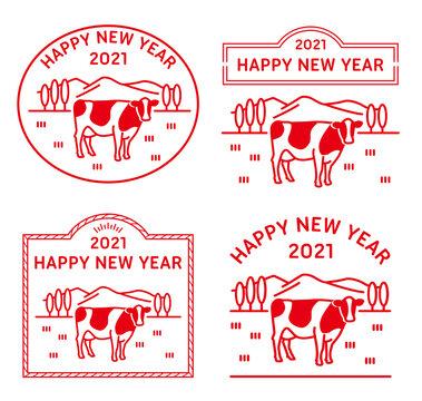 牧場にたたずむ牛のイラストの年賀状