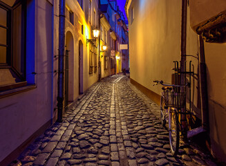 Narrow medieval street at night, old district in European town Fotomurales