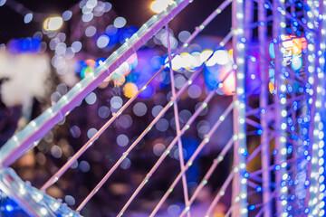Closeup of Christmas lights glowing on the street