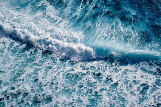 Aerial view to waves in ocean Splashing Waves. Blue clean wavy sea water
