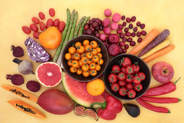 Healthy heart food high in lycopene that can also lower cancer risk with immune boosting super foods high in anthocyanins, antioxidants, vitamins, minerals & dietary fibre, on mottled yellow.