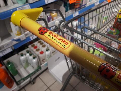 Krakow Poland - April 3, 2020: Biedronka store logo on a shopping trolley handle.