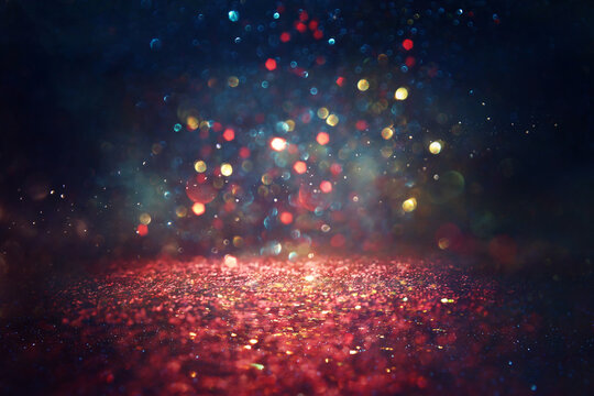 background of abstract red, blue, gold and black glitter lights. defocused