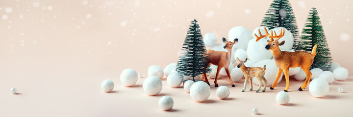 Christmas, winter composition: a family of deer in the winter forest. Happy Christmas and New Years concept. Banner