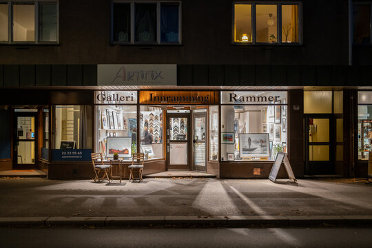 Oslo, Norway - 11/03/2020: Artifix gallery storefront at Sagene with a lot artificial strong lights and shadows on the streets