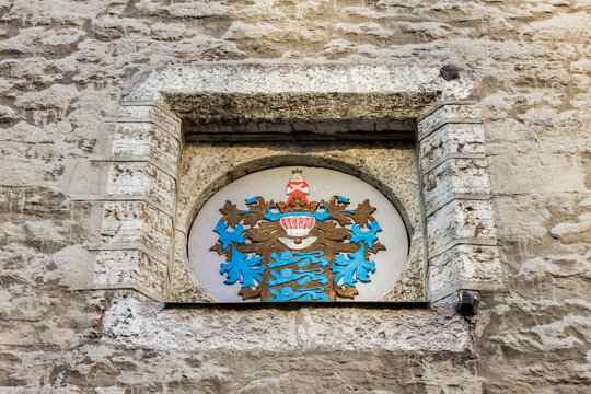 Tallinn, Estonia. Emblem or coat of arms of Tallinn in the facade of Tallinn Town Hall (Tallinna raekoda)