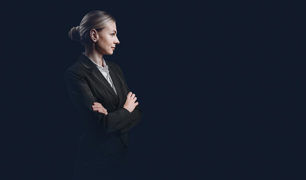 business woman, the concept of a strong and independent business woman. woman in a strict black suit and white buzet on a dark background