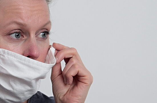 woman with face mask protecting herself from coronavirus on white background stock photo