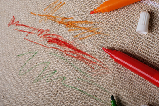 Drawn fabric on the couch with colored pencils. Furniture fabric. Cleaning concept