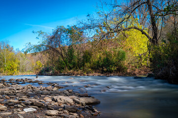 Water flowing over rocks in a river in northwest Arkansas during autumn