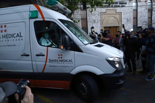 An ambulance carrying Argentine soccer great Diego Maradona arrives at the clinic where he will be undergoing surgery for a subdural haematoma, according to his personal physician, in Olivos