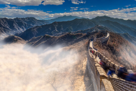 The great wall of china bathed in morning sunlight with moving clouds