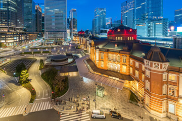Wall Mural - Tokyo Station with modern buildings in Tokyo city, Japan at night