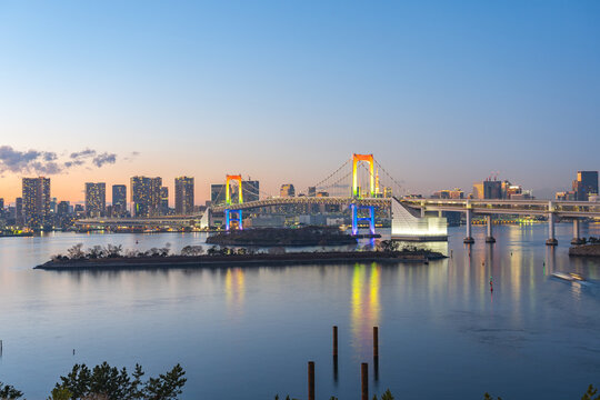 Tokyo bay at night with view of Rainbow Bridge in Tokyo city, Japan