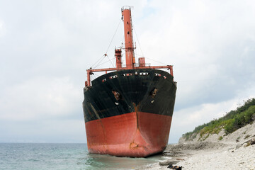 dry cargo ship ran aground near the shore. old abandoned ship standing near Gelendzhik . ship wreck in storm.