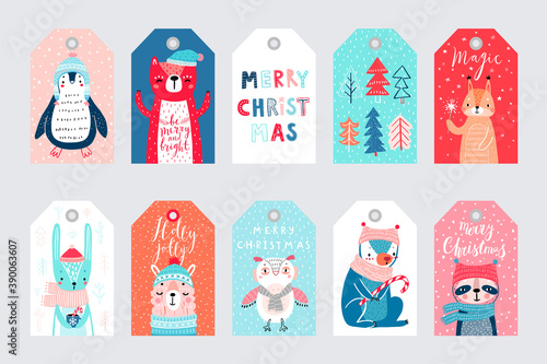 Wall mural Cute gift tags with woodland animals celebrating Christmas eve, having fun, and handwritten letterings. Funny characters.