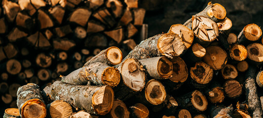 pile of firewood background, close up and landscape photo
