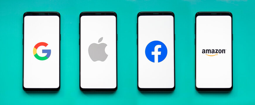 GAFA icons on smartphone screens with blue background banner - Google, Apple, Facebook, Amazon