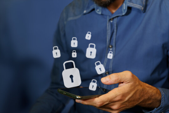 Man using a smartphone with padlock icons. Concept of cybersecurity, online transactions, privacy data and encryption
