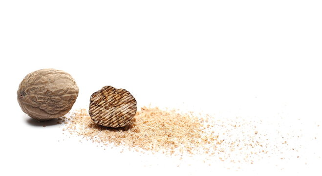 Nutmeg seeds and milled powder isolated on white background