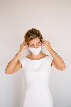 Bride wearing mask at wedding during COVID pandemic