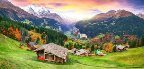 Scenic autumn view of picturesque alpine Wengen village and Lauterbrunnen Valley