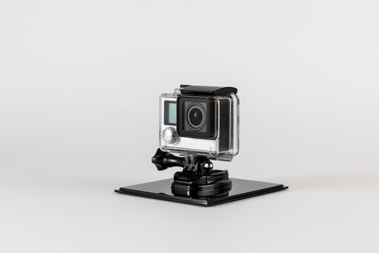 Action camera, compact sports camera in waterproof housing and on stand to keep it stationary