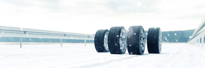 Four winter tires in the snow in winter on the Autobahn