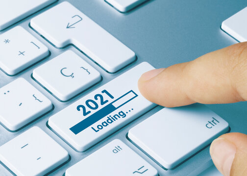 2021 Loading - Inscription on Blue Keyboard Key.