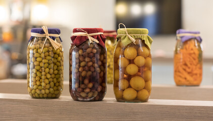 canned vegetables and fruits in glass jars