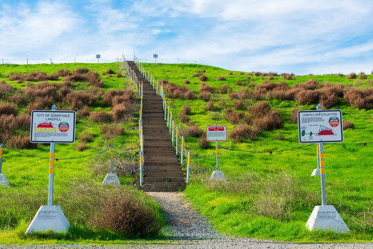 Sign at former landfill informs about waste disposal site and landfill gas collection - Sunnyvale, CA, USA - January, 2020