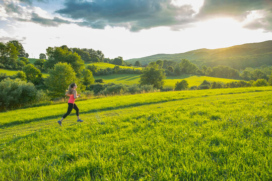 USA, Woman running in field