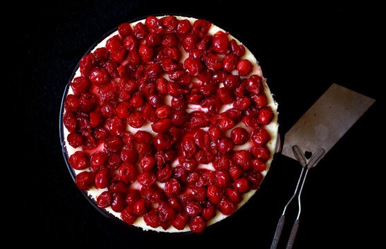 Overhead view of creme fraiche cheesecake with sour cherries
