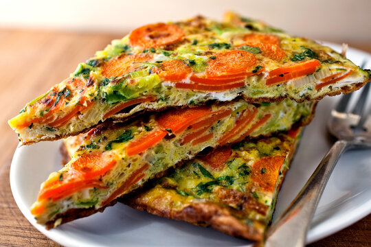 Close up of carrot and leek frittata with tarragon served on plate